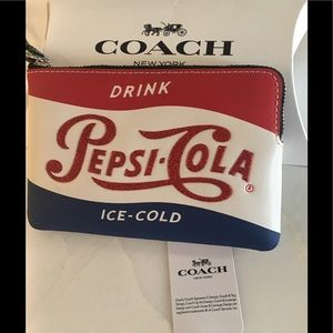 Genuine Coach limited edition(Pepsi-Cola)wristlet.